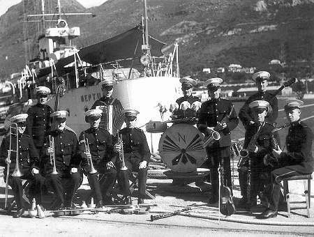 The Royal Marine band on the jetty by the stern of HMS Neptune at Simon's Town in July 1941