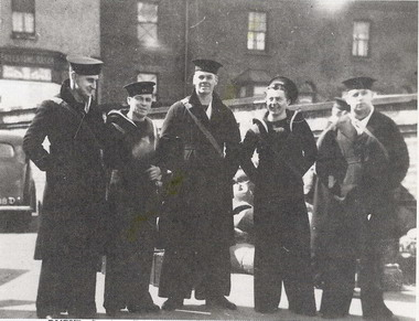 Able Seamen Carrigan, Barker, Cook, Calvert and Birss, all of the Royal New Zealand Volunteer Reserve arrive at Chatham Station in April 1941 for their draft to HMS Neptune